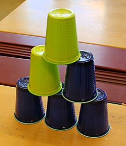 The goal is to get the cups stacked like this.