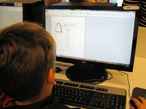 Copy-pasting clip art onto the empty bingo board to create personal Halloween bingo cards
