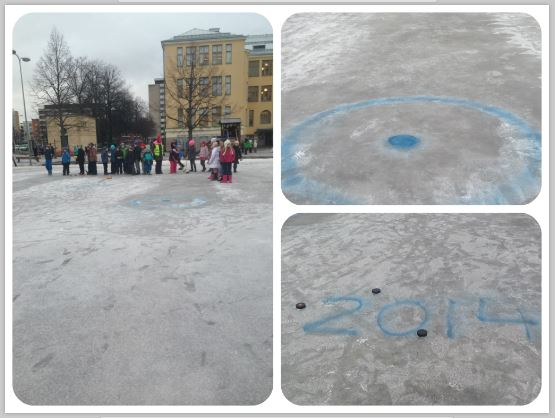 Today's recess Olympics event was curling in spite of the fact that most of the ice rink in the school yard has melted away.